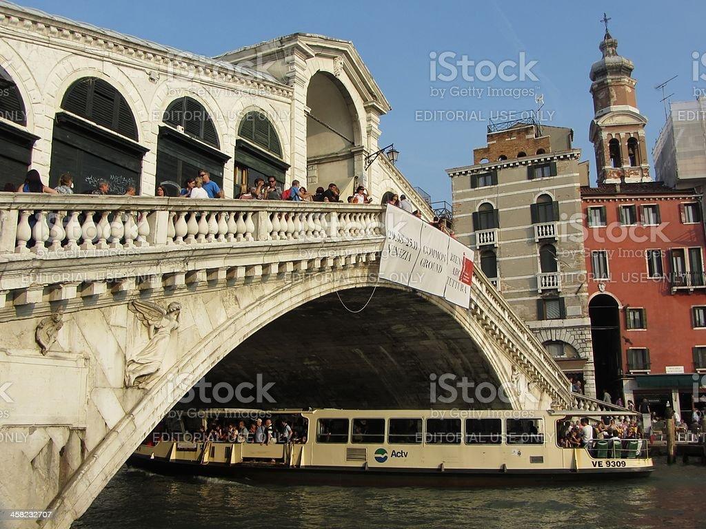 Water Bus Passing Under the Bridge royalty-free stock photo