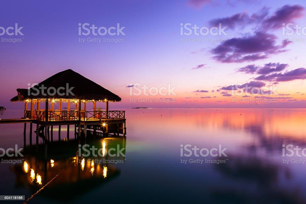 Water cafe at sunset - Maldives royalty-free stock photo