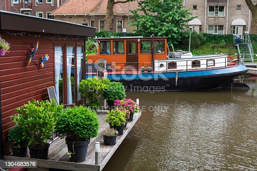 Water canal and old boats in Rotterdam, Netherlands.