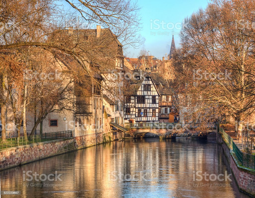 Water Canal In Strasbourg Beautiful reflections in a water canal during winter in Strasbourg. Architecture Stock Photo