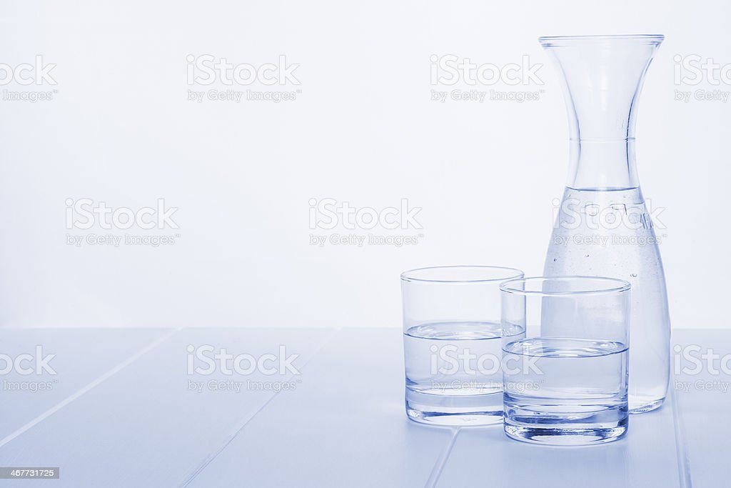 Water Carafe and Two Glasses stock photo