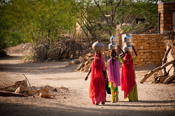 water carriers - village stock photos and pictures