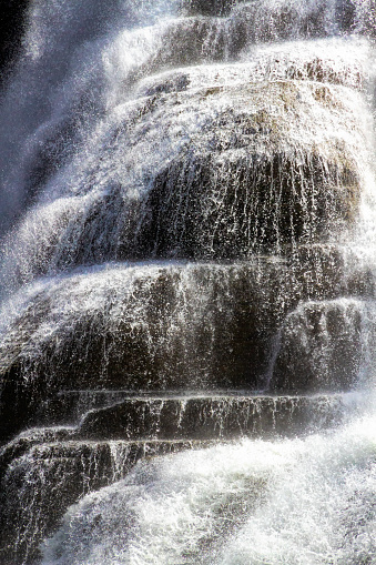 Close uo view of Ithaca Falls showing water cascading over rocks.