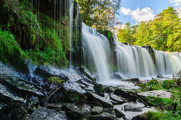 water cascading down from keila-joa waterfall, estonia - estonya stok fotoğraflar ve resimler