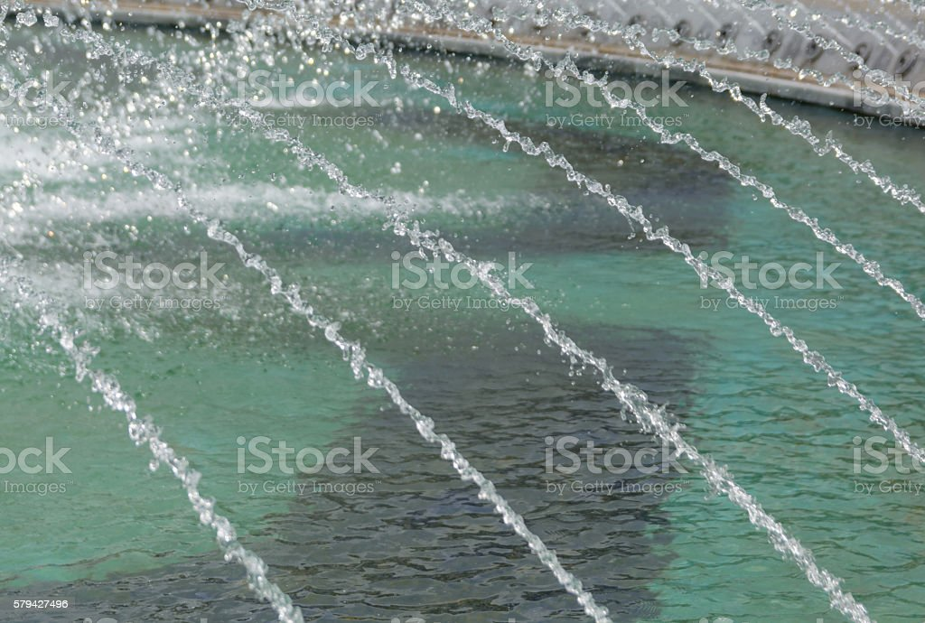 Water cascading from outdoor fountain stock photo