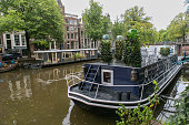 amsterdam, netherland - August 17, 2014: water channels are  with traditional house boats at amsterdam holland netherland