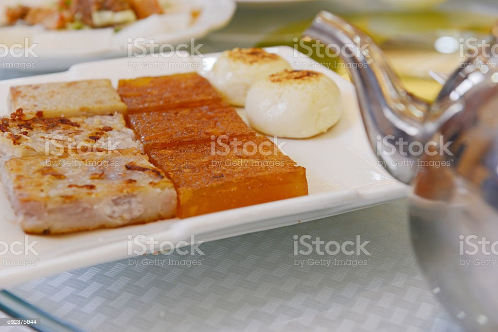 Water chestnut cakes ,taro cakes and Chinese traditional steamed breads. stock photo