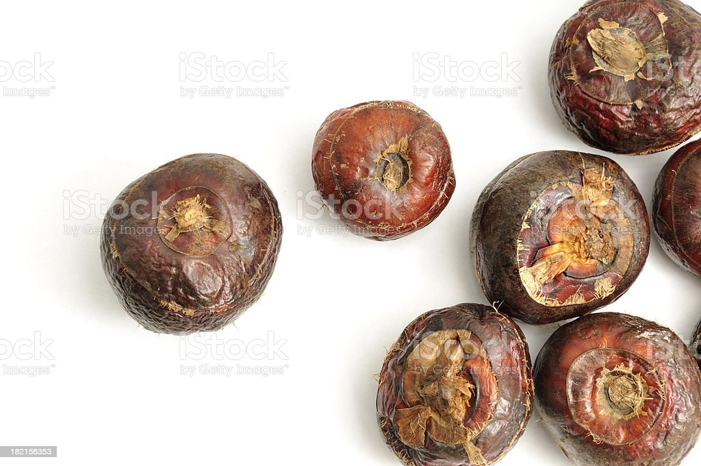 Water chestnuts scattered stock photo