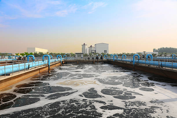 Water cleaning facility outdoors Water recycling in big sedimentation drainages. sewage treatment plant stock pictures, royalty-free photos & images