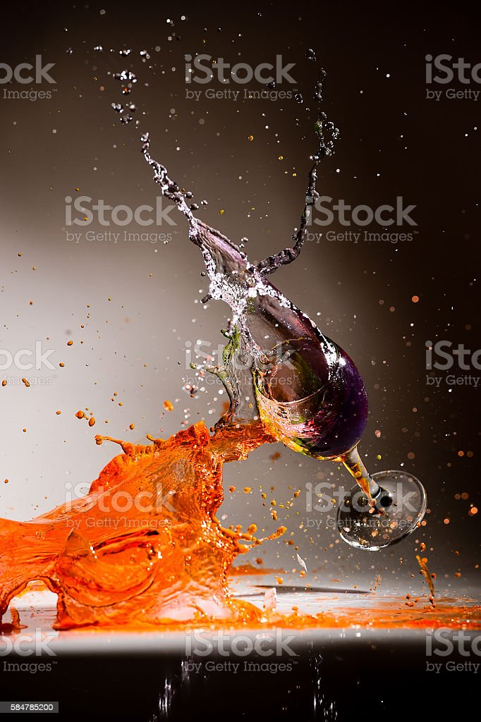 Water color splashing in glass wine on isolated background stock photo