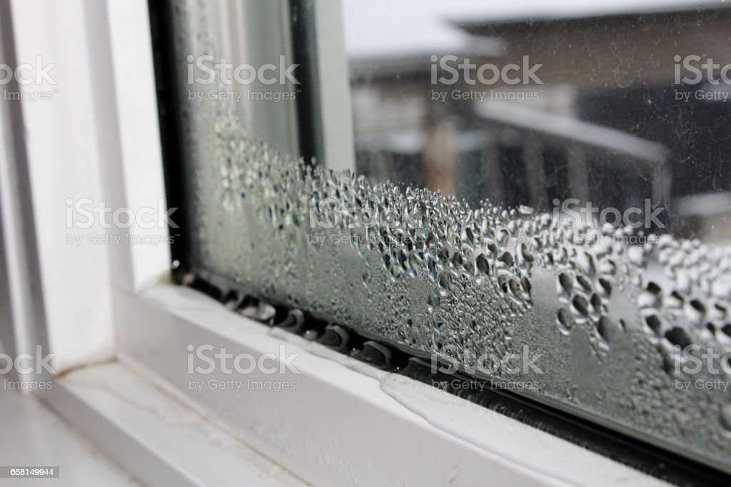 Water condensation on windows during winter stock photo