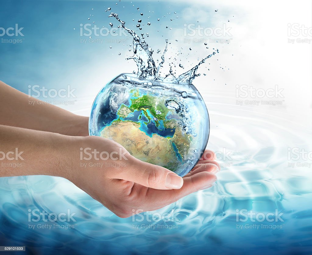 water conservation in Europe - water globe in the hands stock photo