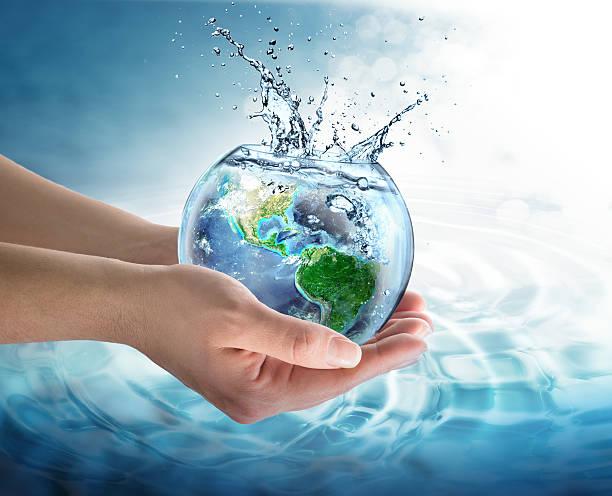 conservation dans de l'eau le notre planète-usa - recyclage main photos et images de collection