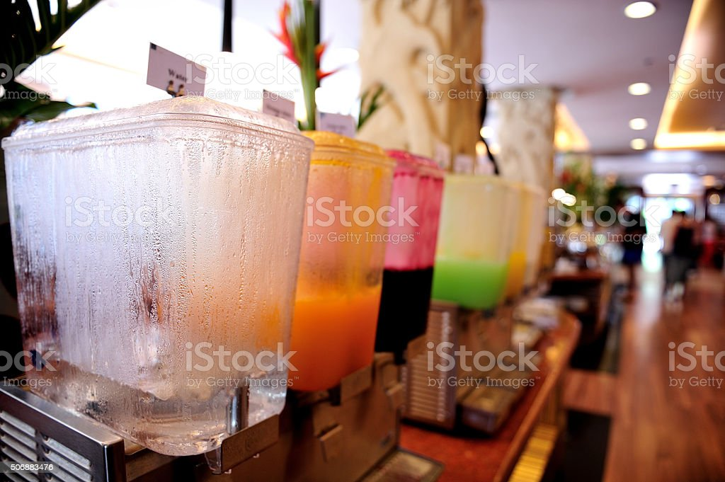 Closeup of Guava and Orange juice in water cooler for guess of...