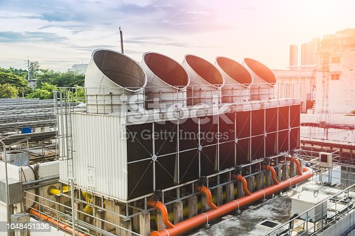 istock Water cooling tower air chiller HVAC of large industrial building air conditioner. 1048451336