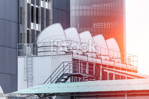 istock Water cooling tower air chiller HVAC of large industrial building air conditioner. 1054742964