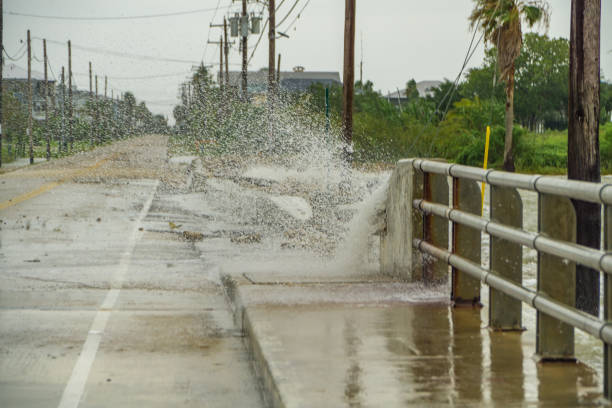 Water crashing over a road near Galveston Bay just outside of Houston Texas stock photo