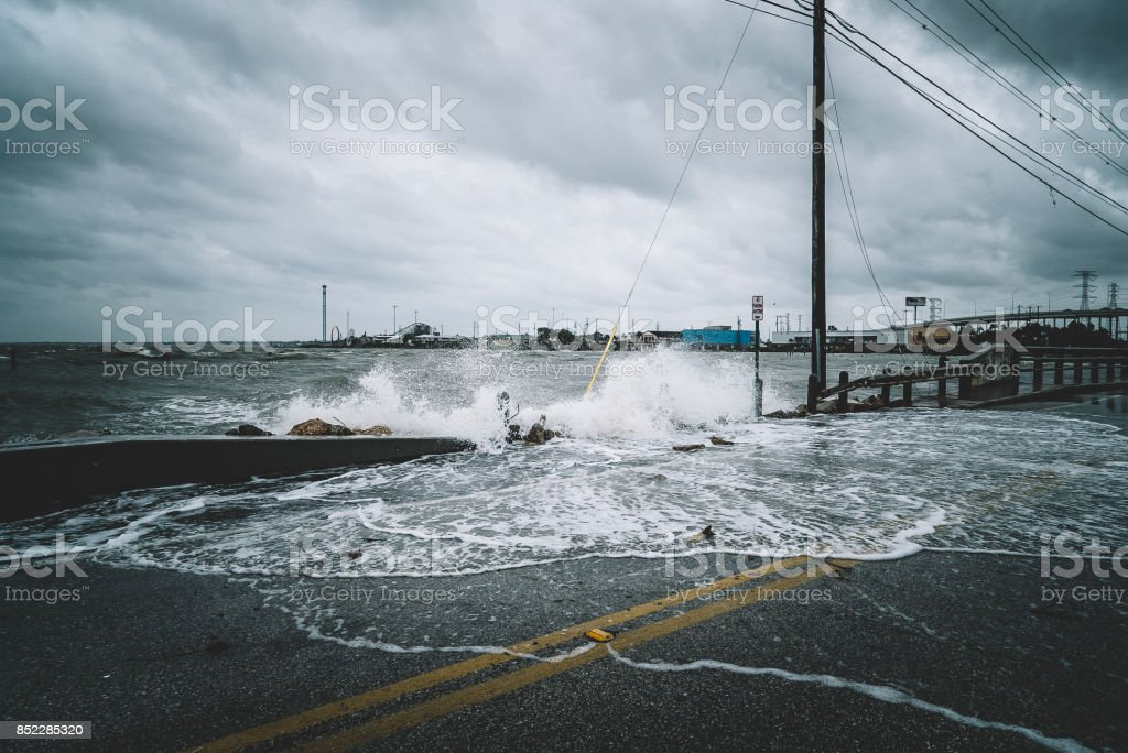 Water crashing over bridge during Hurricane stock photo