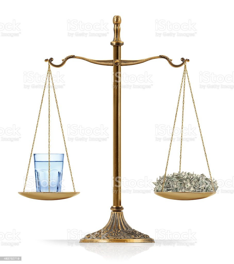 """Water Crisis Water issue concept: There is a glass of water at the one side of """"Scales of Justice"""" while there is a lot of money on the other side. A glass of water and money are equal weighted. Isolated on white background. American One Hundred Dollar Bill Stock Photo"""