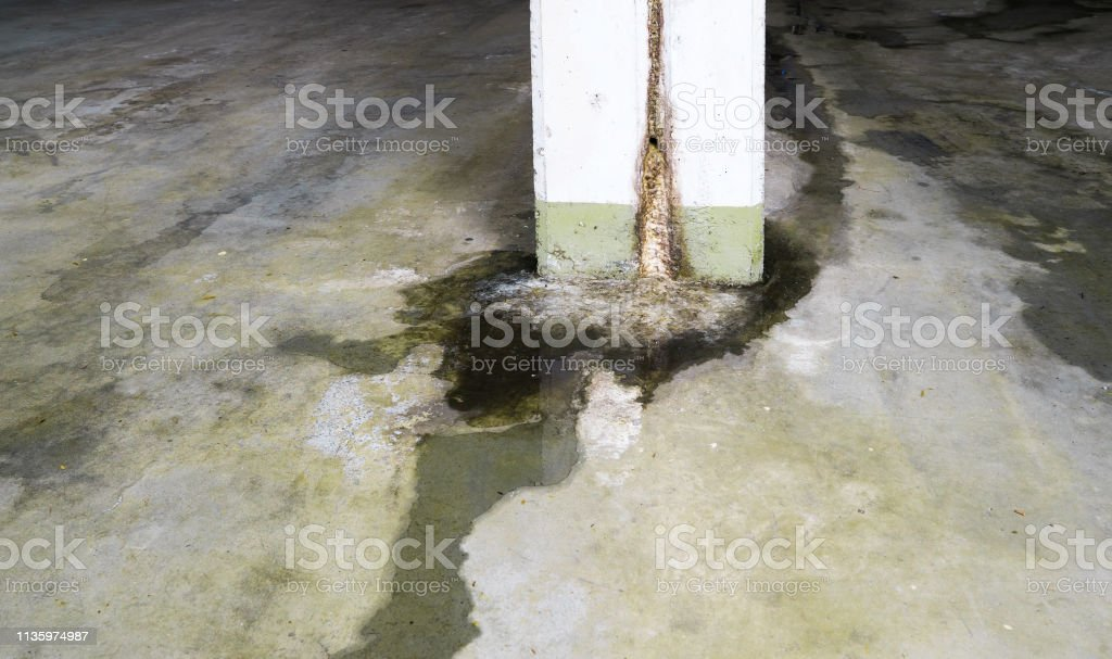 water damage in concrete construction with calcium and rust deposits...