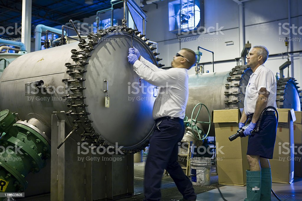 Water Department Maintenance Technicians Open Filter Tank stock photo