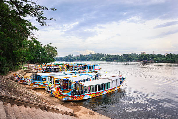 Water dragons of Huong River, Hue, Vietnam Passenger boats on Huong River, under the foot of Thien Mu Pagoda, Hue City, Vietnam - 2015 huế stock pictures, royalty-free photos & images