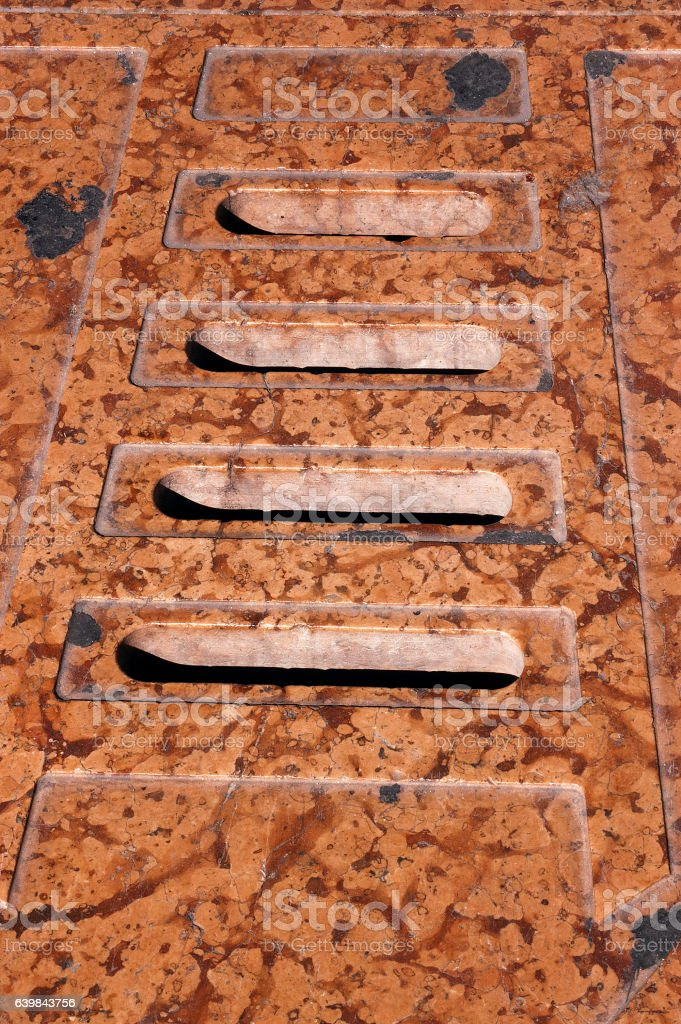 Water Drain in Red Marble - Italy stock photo