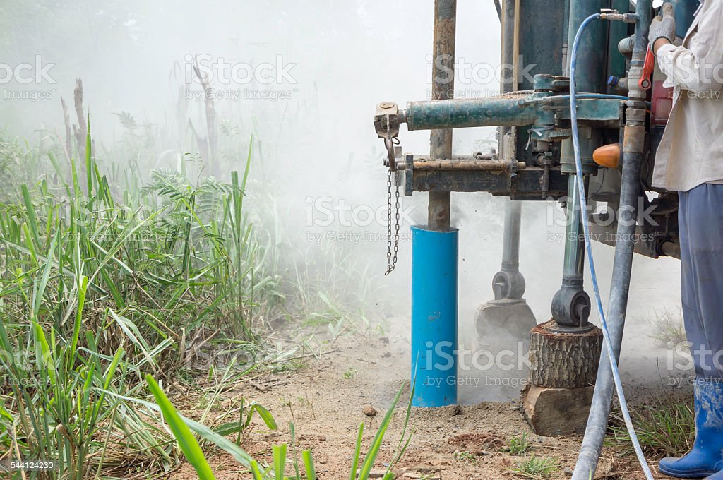 Water drilling rigs underground stock photo