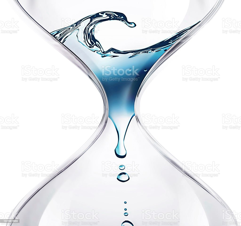 Water dripping through an hourglass stock photo