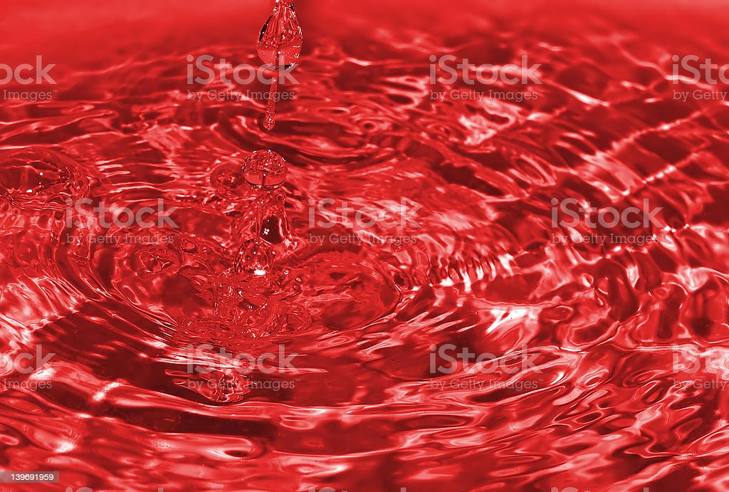water drop captured on impact with the still water surface royalty-free stock photo