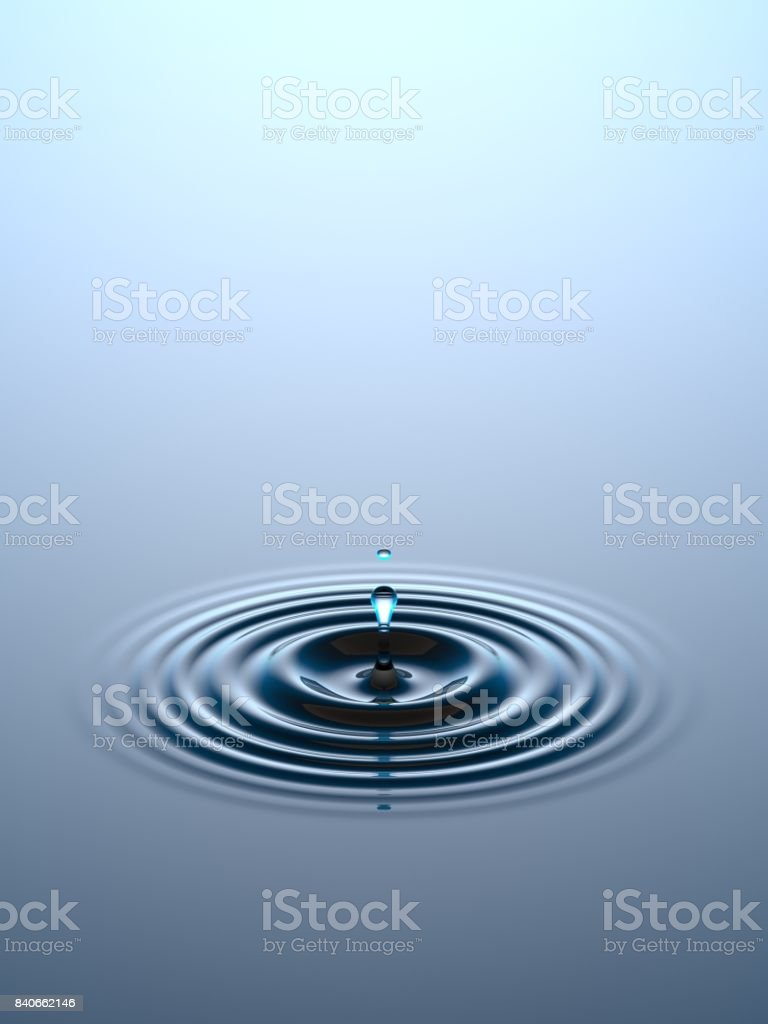 Water drop falling into water surface stock photo