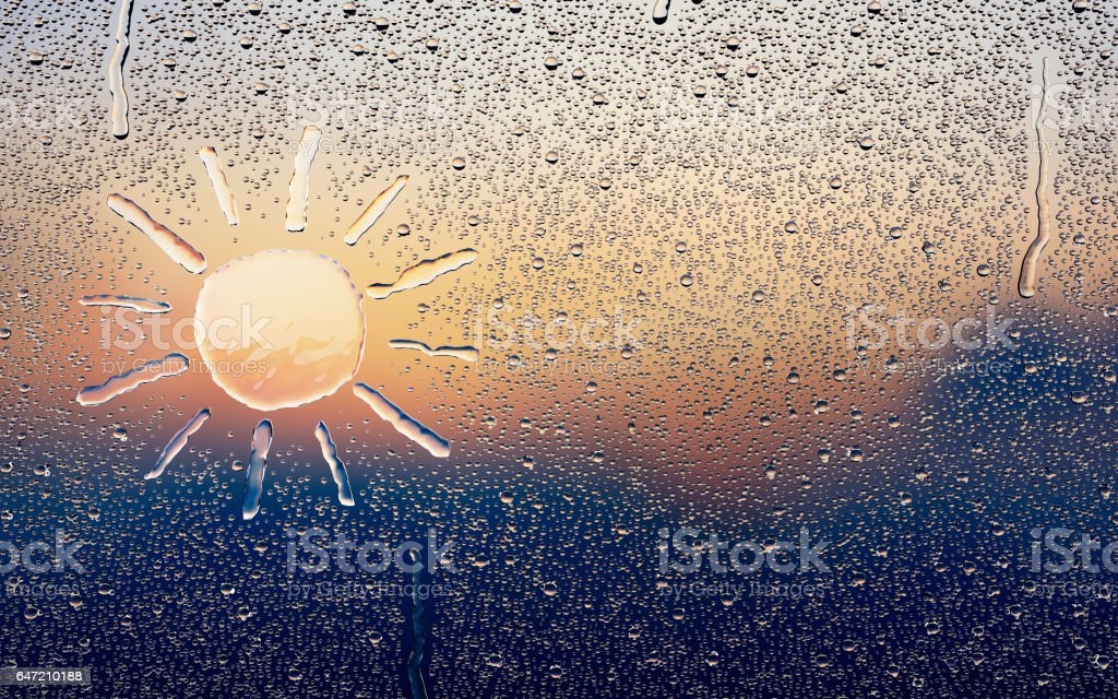 Water drop forming a sun stock photo