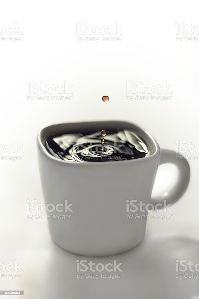 Water drop in Coffee royalty-free stock photo