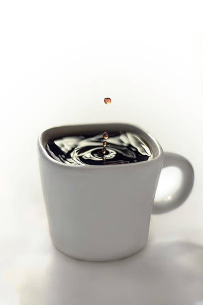 Water drop in Coffee stock photo
