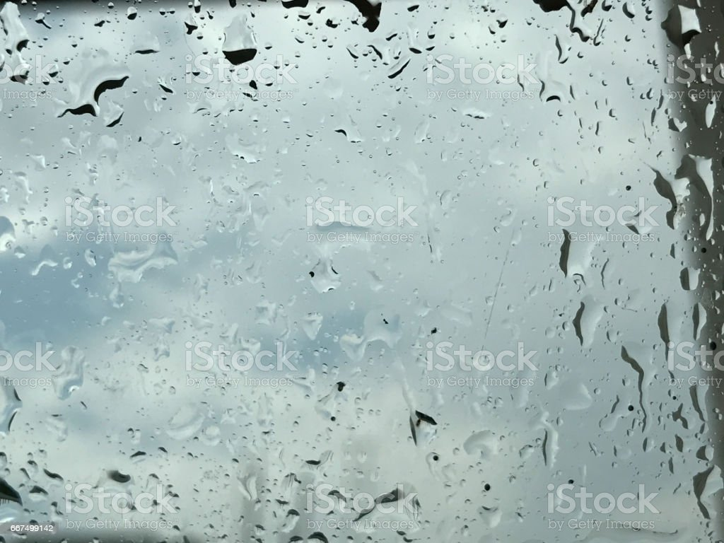 water drop on glass in raining day foto stock royalty-free