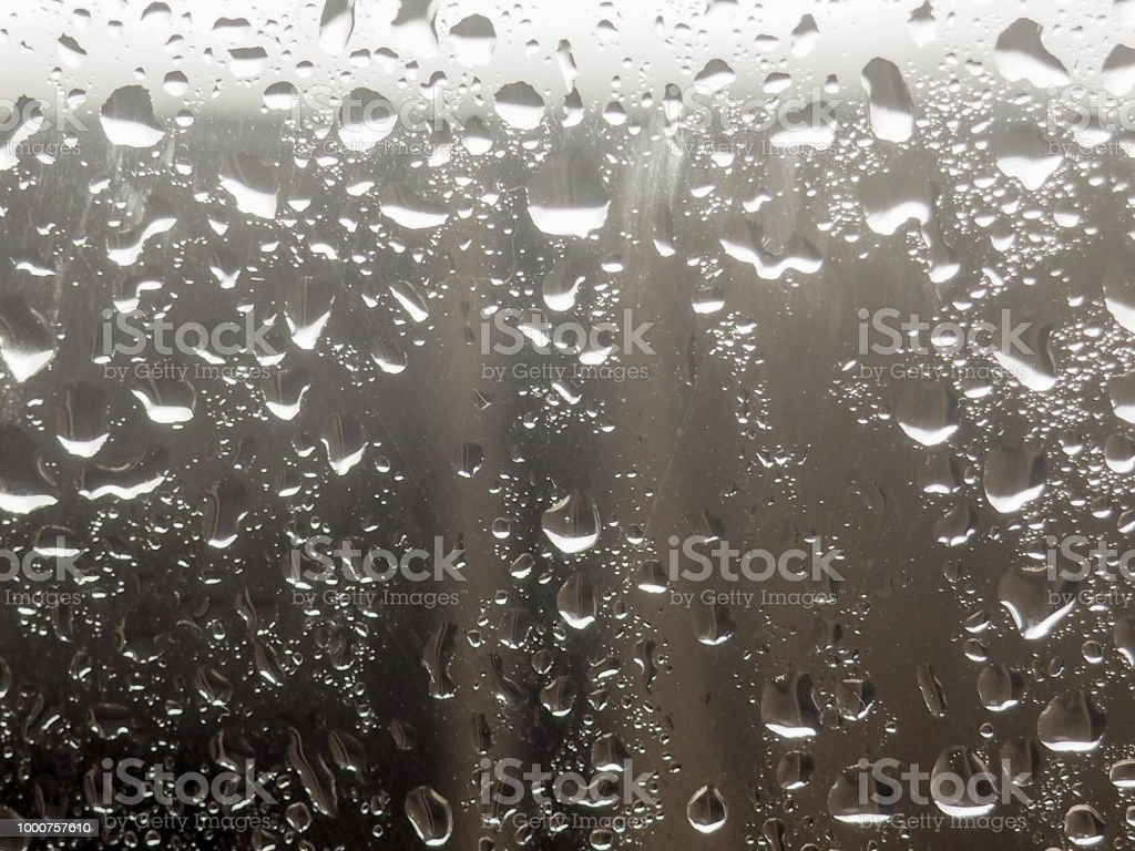 water drop on the glass of windows background raining on the glass