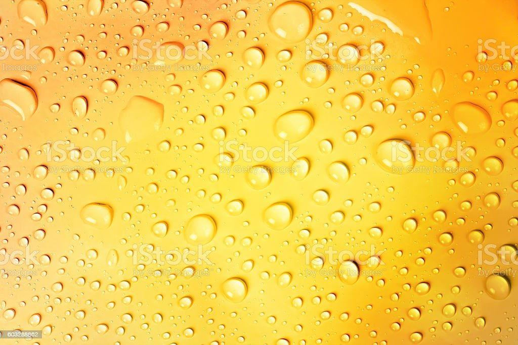 water drop on yellow gold background royalty free stock photo