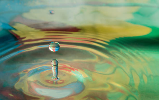 water drop splash - macrophotography stock pictures, royalty-free photos & images