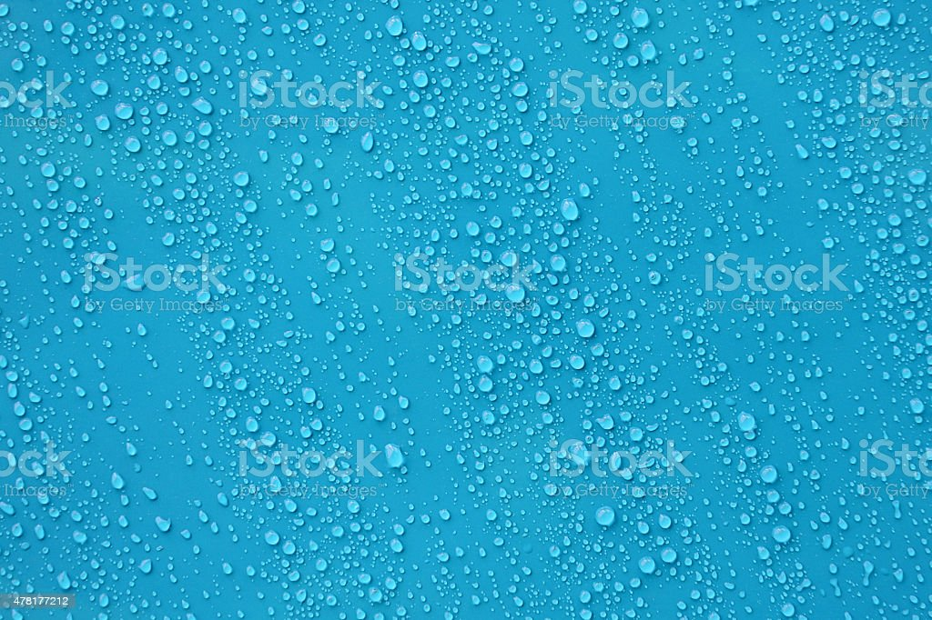 Water drop texture on blue background. stock photo