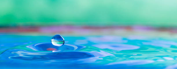 Water droplet splash photograph color photo of a water droplet splash front view spa belgium stock pictures, royalty-free photos & images