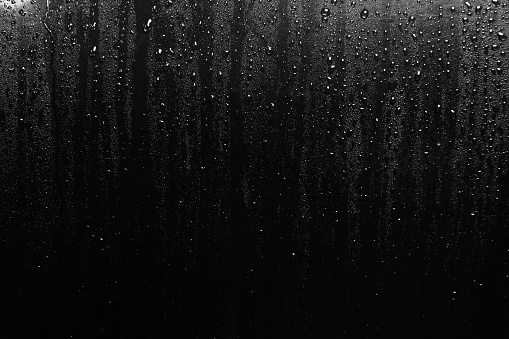 Water Droplets form on Black Metal surface