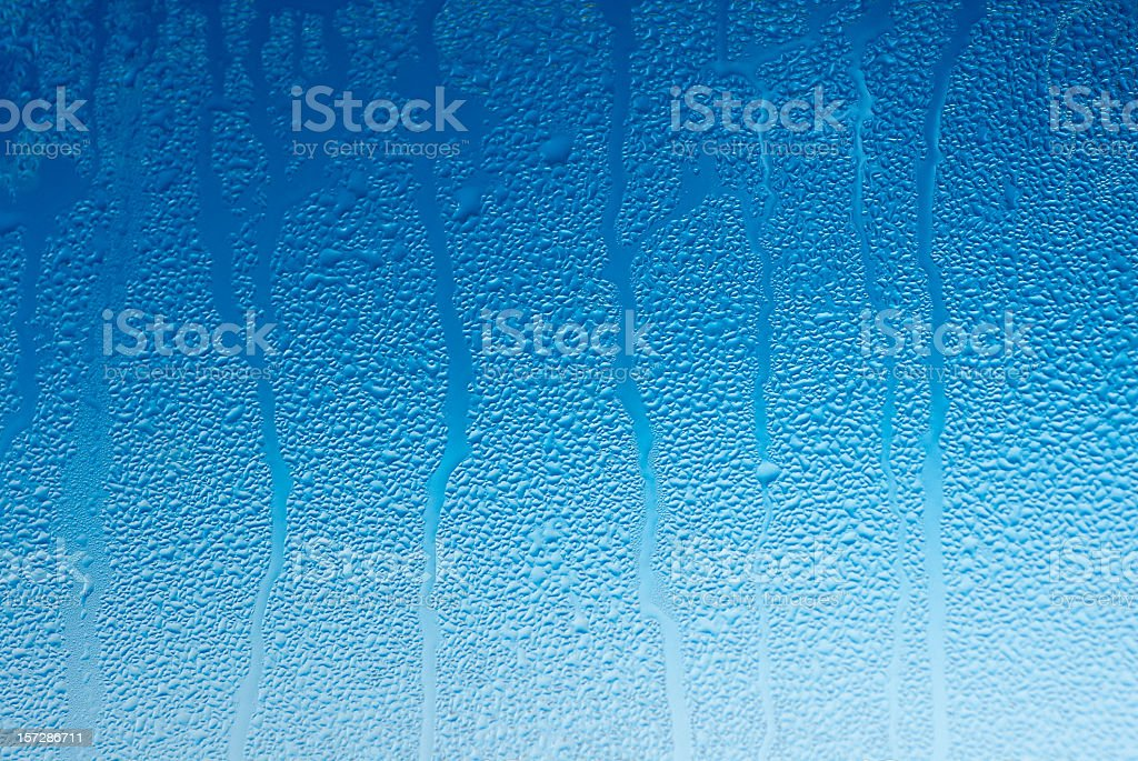 Water droplets on a blue window royalty-free stock photo