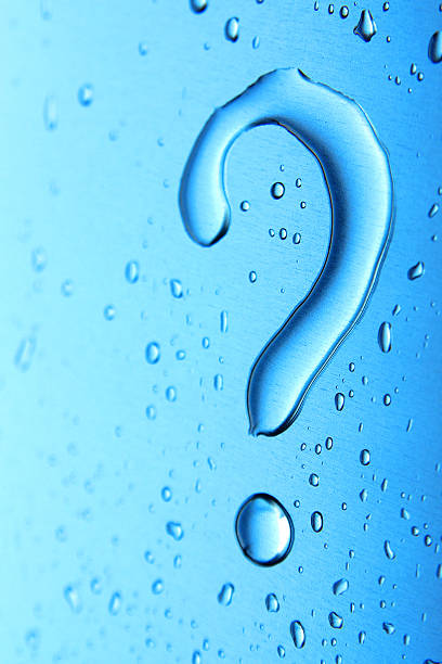 Water droplets on blue background in question mark shape stock photo