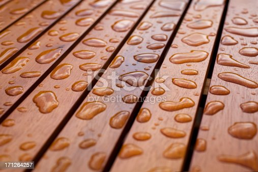 Water droplets on wood.