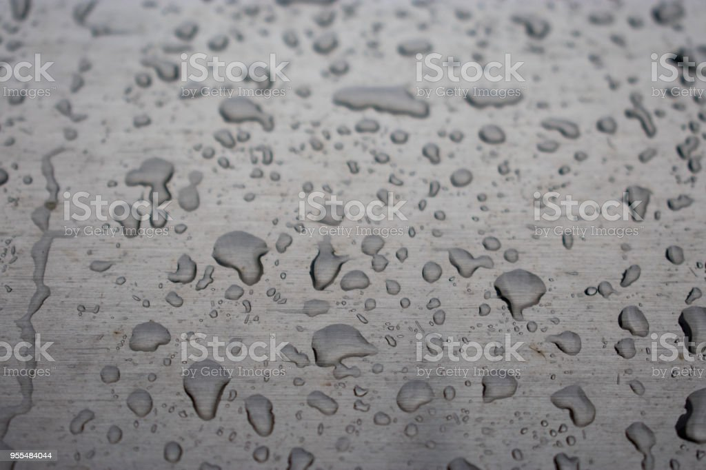 water droplets rain on chrome stock photo