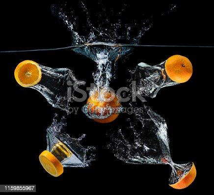1169153675 istock photo Water dropping slice orange fruits. 1159855967