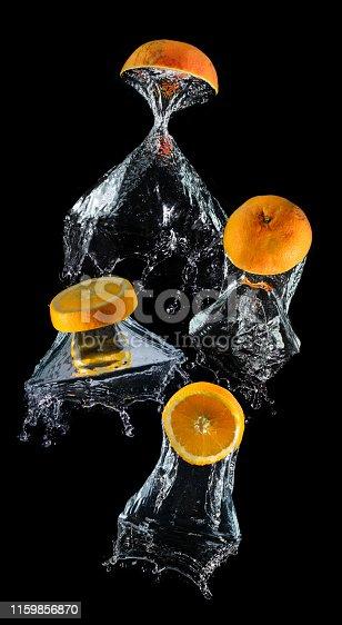 1169153675 istock photo Water dropping slice orange fruits. 1159856870