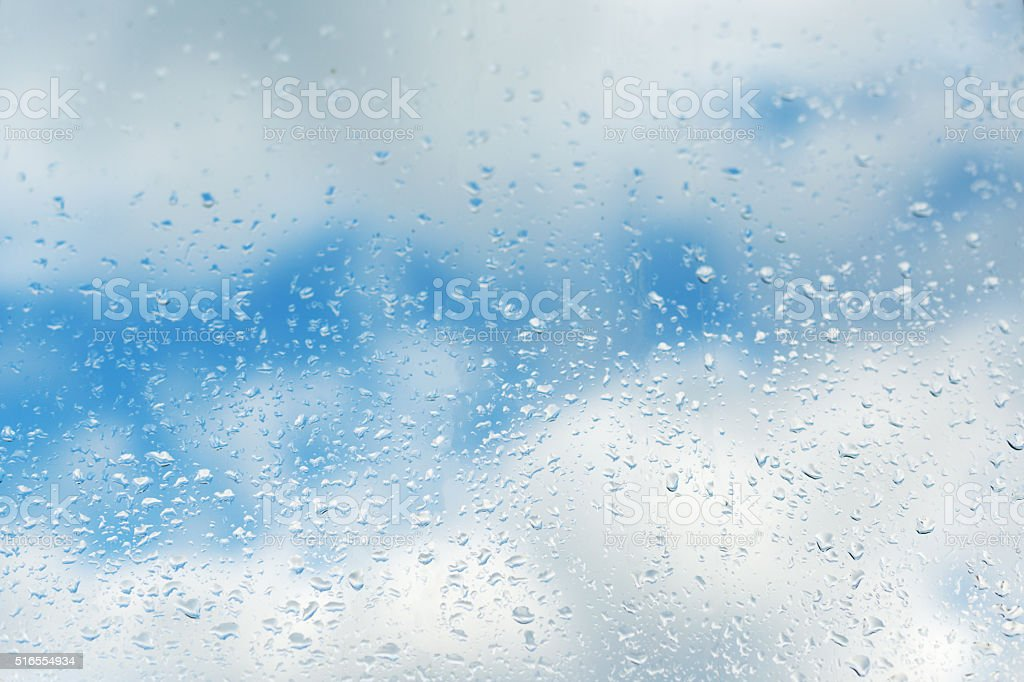 Water drops against sky stock photo