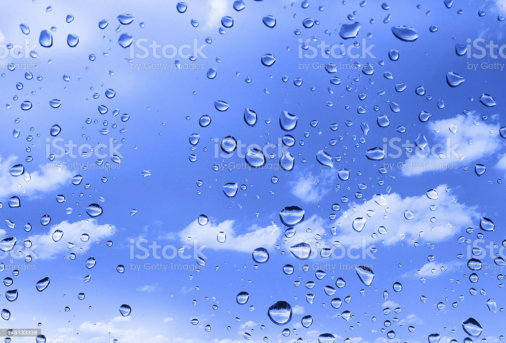 water drops against summer sky stock photo