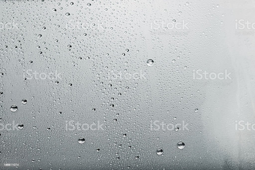 Water drops background Dew condensation texture on ice cold  glass royalty-free stock photo